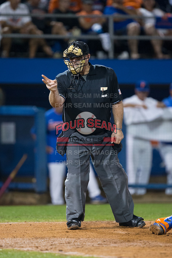 Home plate umpire Tony Norris calls strike two during Game One of the Gainesville Super Regional of the 2017 College World Series between the Wake Forest Demon Deacons and the Florida Gators at Alfred McKethan Stadium at Perry Field on June 10, 2017 in Gainesville, Florida.  The Gators defeated the Demon Deacons 2-1 in 11 innings.  (Brian Westerholt/Four Seam Images)