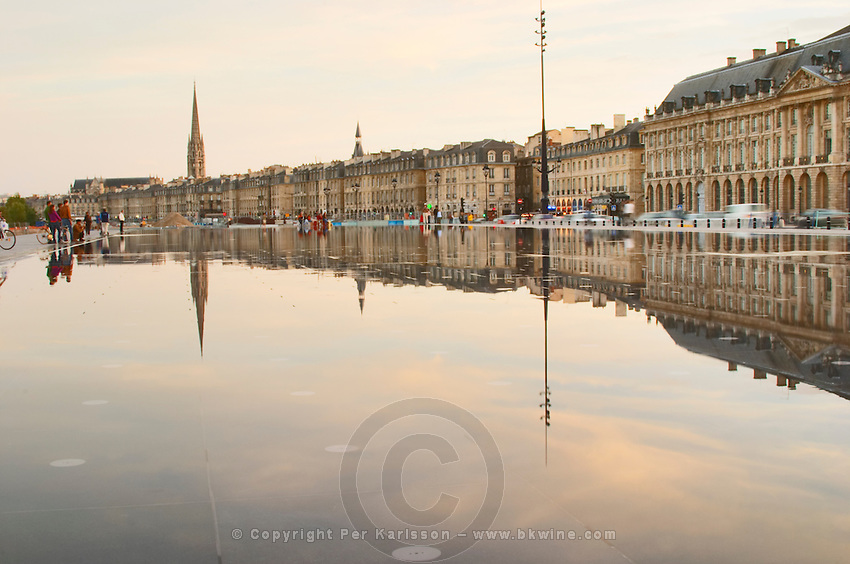 Tower and church Eglise Saint Michel reflected in the fountain. On Les Quais. Place de la Bourse. The new fountain Miroir d'Eau, Water Mirror, making reflections. Bordeaux city, Aquitaine, Gironde, France
