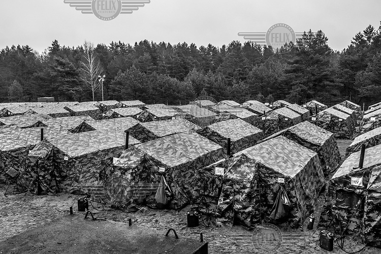 Tents to accommodate troops from several countries including US, Canada, UK, Czech Republic, Georgia and Lithuania during NATO Iron Sword joint exercises.