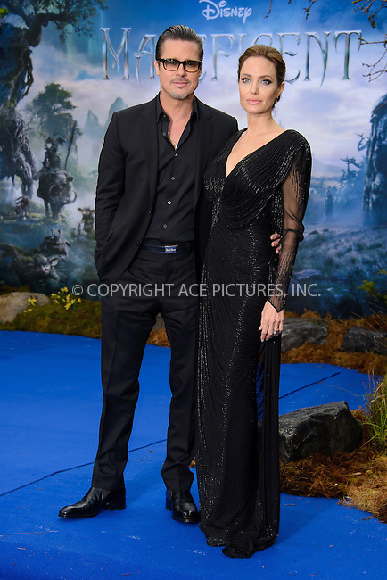 ACEPIXS.COM<br /> <br /> May 8 2014, London<br /> <br /> Brad Pitt and Angelina Jolie at a private reception as costumes and props from Disney's 'Maleficent' are exhibited in support of Great Ormond Street Hospital at Kensington Palace on May 8, 2014 in London<br /> <br /> By Line: Famous/ACE Pictures<br /> <br /> ACE Pictures, Inc.<br /> www.acepixs.com<br /> Email: info@acepixs.com<br /> Tel: 646 769 0430