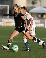 23 July 2009:  Leslie Osborne of the FC Gold Pride kicks the ball away from Camille Abily of the Los Angeles Sol during the first half of the game at Buck Shaw Stadium in Santa Clara, California.   FC Gold Pride tied Los Angeles Sol, 0-0.