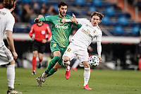 6th February 2020; Estadio Santiago Bernabeu, Madrid, Spain; Copa Del Rey Football, Real Madrid versus Real Sociedad; Mikel Merino (Real Sociedad) challenges for the ball with Luka Modric (Real Madrid)