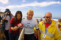 Mick Fanning (AUS) being escorted up the beach by David Woody Wood (AUS) after he had won the 2001 Rip Curl Pro at Bells Beach, Victoria, Australia. Fanning was a sponsors wildcard and stormed the field, defeating Danny Wills (AUS) in the finals. Photo: joliphotos.com