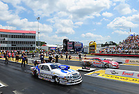 May 6, 2012; Commerce, GA, USA: NHRA  pro stock driver Allen Johnson (near lane) races alongside Greg Anderson during the Southern Nationals at Atlanta Dragway. Mandatory Credit: Mark J. Rebilas-