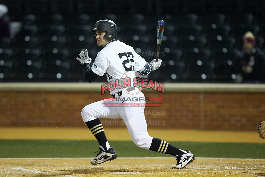 Michael Ludowig (22) of the Wake Forest Demon Deacons follows through on his swing against the Florida State Seminoles at David F. Couch Ballpark on March 9, 2018 in  Winston-Salem, North Carolina.  The Seminoles defeated the Demon Deacons 7-3.  (Brian Westerholt/Four Seam Images)