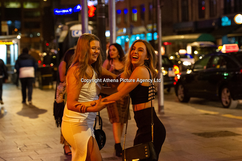 Pictured: Revellers in St Marys Street, Cardiff. Monday 31 December 2018 <br /> Re: New Year revellers in St Marys Street, Cardiff, Wales, UK