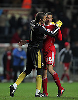 ATTENTION SPORTS PICTURE DESK<br /> Pictured L-R: David James goalkeeper for Bristol hugs team mate Steven Caulker after their win against Swansea<br /> Re: npower Championship, Swansea City FC v Bristol City Football Club at the Liberty Stadium, south Wales. Wednesday 10 November 2010