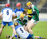 XXjob 06/05/2015 SPORT<br /> Limerick Darragh Carroll &amp;  Seamus Flanagan &amp; Waterford's Jordan Henley &amp; Darragh Lyons  in Action during their 2015 Electric Ireland Munster GAA Hurling Minor Championship.<br /> Picture  Credit Brian Gavin Press 22