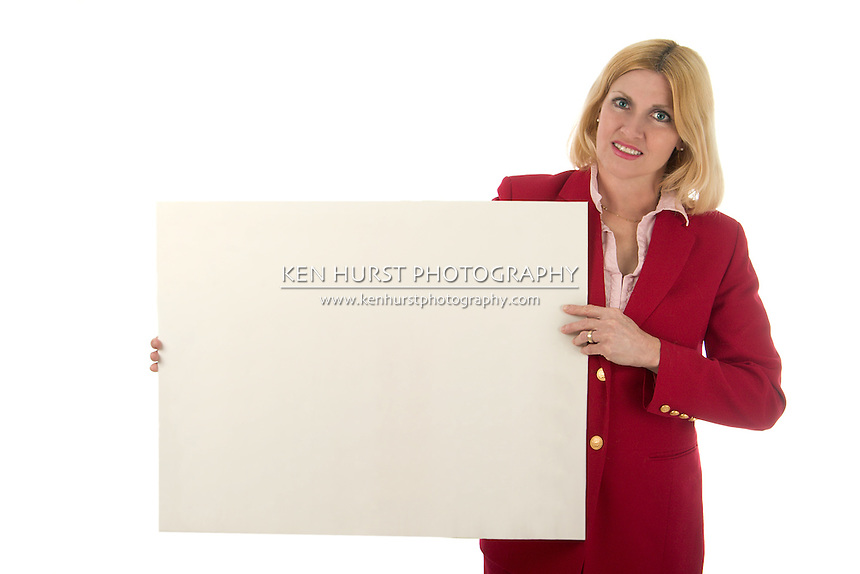 Proud woman business executive displaying her chart by holding up an invisible sign.