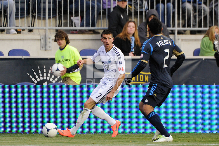 Sebastien Le Toux (7) of the Vancouver Whitecaps is defended by Carlos Valdes (2) of the Philadelphia Union. The Philadelphia Union and the Vancouver Whitecaps played to a 0-0 tie during a Major League Soccer (MLS) match at PPL Park in Chester, PA, on March 31, 2012.