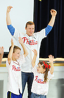 "Phillies outfielder Cody Asche (center) dances to ""YMCA"" with Barclay Elementary School students Liam (left) and Katie Petersen (right) for a special assembly Wednesday June 17, 2015 in Warrington, Pennsylvania. Liam and Kate Petersen's parents won the unique experience through the Phillies Charities, Inc. Phantastic Auction. (Photo by William Thomas Cain)"