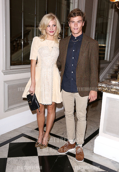 Pixie Lott and Oliver Cheshire arriving at the Temperley catwalk show as part of London Fashion Week SS13, New Connaught Rooms, Covent Garden, London. 16/09/2012 Picture by: Henry Harris / Featureflash
