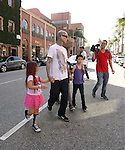 May 22nd 2012<br /> <br /> Travis Barker holding hands with his kids in Beverly Hills . Landon and Alabama