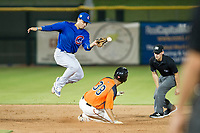 AZL Cubs second baseman Carlos Sepulveda (16) attempts to apply a tag to Aaron Bond (38) during Game Three of the Arizona League Championship Series against the AZL Giants on September 7, 2017 at Scottsdale Stadium in Scottsdale, Arizona. AZL Cubs defeated the AZL Giants 13-3 to win the series two games to one. (Zachary Lucy/Four Seam Images)