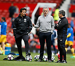Jose Mourinho manager of Manchester United talks to his coaches before kick off during the English Premier League match at the Old Trafford Stadium, Manchester. Picture date: May 21st 2017. Pic credit should read: Simon Bellis/Sportimage
