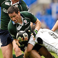 Reading, ENGLAND, Exiles, scrum half, Ben Willis, is caught by Kyran Bracken's tackle, during the London Irish vs Saracens, Guinness Premiership Rugby, at the, Madejski Stadium, 06.05.2006, © Peter Spurrier/Intersport-images.com,  / Mobile +44 [0] 7973 819 551 / email images@intersport-images.com.