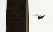 Marine One, with United States President Barack Obama aboard, flies past the Washington Monument from the South Lawn of the White House en route to Martha's Vineyard for a ten day vacation on Thursday, August 18, 2011 in Washington. .Credit: Roger L. Wollenberg / Pool via CNP