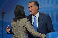 March 14, 2013  (National Harbor, Maryland)  Former Republican presidential candidate Mitt Romney greets Governor Nikki Haley, R-SC, as he prepares to address  the 2013 Conservative Political Action Conference (CPAC) in National Harbor, MD.  (Photo by Don Baxter/Media Images International)