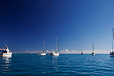FRENCH POLYNESIA, Moorea. Sailboats anchored along the coast.