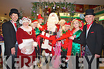 TAPE: Santa waits for the sissors to open his Santa Cave in CH Chemist on Saturday ,L-r:  Peter Harty,Orla Conlon (Mrs Clause), Eilish Griffin, Shannon Clarke, Santa, Ann Sugrue ( Godmother),Deirdre Kennelly,Ciara Rogers and Peter Reardan............................ ..........