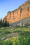 Sunrise lights the Chinese Wall in the Bob Marshall Wilderness area in Montana