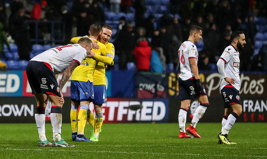 Leeds United players celebrate victory as Bolton Wanderers' players despair<br /> <br /> Photographer Andrew Kearns/CameraSport<br /> <br /> The EFL Sky Bet Championship - Bolton Wanderers v Leeds United - Saturday 15th December 2018 - University of Bolton Stadium - Bolton<br /> <br /> World Copyright © 2018 CameraSport. All rights reserved. 43 Linden Ave. Countesthorpe. Leicester. England. LE8 5PG - Tel: +44 (0) 116 277 4147 - admin@camerasport.com - www.camerasport.com