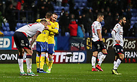 Leeds United players celebrate victory as Bolton Wanderers' players despair<br /> <br /> Photographer Andrew Kearns/CameraSport<br /> <br /> The EFL Sky Bet Championship - Bolton Wanderers v Leeds United - Saturday 15th December 2018 - University of Bolton Stadium - Bolton<br /> <br /> World Copyright &copy; 2018 CameraSport. All rights reserved. 43 Linden Ave. Countesthorpe. Leicester. England. LE8 5PG - Tel: +44 (0) 116 277 4147 - admin@camerasport.com - www.camerasport.com
