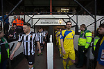 The players walking on to the pitch at Victory Park, before Chorley played Altrincham (in yellow) in a Vanarama National League North fixture. Chorley were founded in 1883 and moved into their present ground in 1920. The match was won by the home team by 2-0, watched by an above-average attendance of 1127.