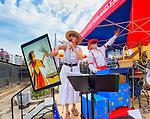 Brooklyn, New York, USA. 10th August 2013.  ORGAN GRINDER LOLA (Christiana Drapkin) and MASTER BOB  entertain visitors during the 3rd Annual Coney Island History Day celebration.