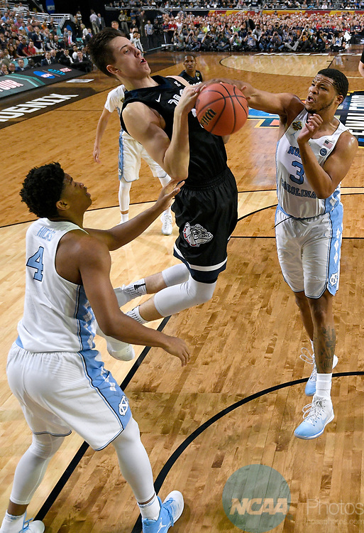 GLENDALE, AZ - APRIL 03: Zach Collins #32 of the Gonzaga Bulldogs gets blocked by Kennedy Meeks #3 of the North Carolina Tar Heels during the 2017 NCAA Men's Final Four National Championship game at University of Phoenix Stadium on April 3, 2017 in Glendale, Arizona.  (Photo by Chris Steppig/NCAA Photos via Getty Images)