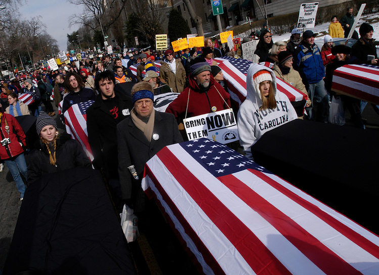 Protesters carry mock solider coffins during a protest against the 2005 Presidential Inauguration.