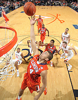 Feb. 2, 2011; Charlottesville, VA, USA; Clemson Tigers forward Milton Jennings (24) grabs a rebound during the game against the Virginia Cavaliers at the John Paul Jones Arena. Virginia won 49-47. Mandatory Credit: Andrew Shurtleff