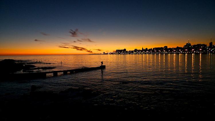 Lonely fishermen in Playa Ramirez contemplating the beautiful sunset.