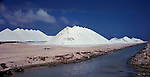 Mounds of salt piled up and drying in the sun at the Bonair salt works. Bonair, Netherland Antilles.