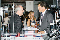 "Jay Faison, Founder and CEO of ClearPath Foundation, (right) speaks with Jack Gerard, president and CEO of the American Petroleum Institute, after being on a panel put on by the Washington Post called ""Party Platform: Energy and Environment,"" at Butcher and the Brewer outside the Republican National Convention in Cleveland, Ohio, on Tues., July 19, 2016."
