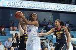 03 January 2013: North Carolina's Tierra Ruffin-Pratt (44) pulls down a rebound between Maryland's Alicia DeVaughn (13) and Tierney Pfirman (left). The University of North Carolina Tar Heels played the University of Maryland Terrapins at Carmichael Arena in Chapel Hill, North Carolina in an NCAA Division I Women's Basketball game. UNC won the game 60-57.