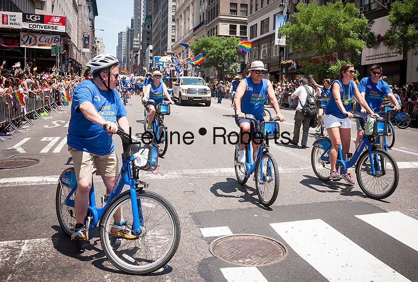 CitiBank employees on CitiBikes in the annual Lesbian, Gay, Bisexual and Transgender Pride Parade on Fifth Avenue in New York on Sunday, June 29, 2014. The parade commemorates the 45th anniversary of the Stonewall Inn riots in Greenwich Village which many feel is the start of the gay rights movement in 1969. The parade is the largest gay pride parade in the world.(© Richard B. Levine)