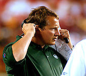Landover, MD - August 19, 2006 -- New York Jets head coach Eric Mangini adjusts his head set during the preseason action against the  Washington Redskins at FedEx Field in Landover, Maryland, Saturday, August 19, 2006.<br />