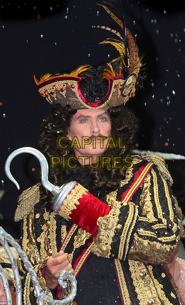 DAVID HASSELHOFF.First Family Entertainment 2011 Pantomimes Photocall at the Piccadilly Theatre, London, November 26th 2010..panto costume half length captain hook gold wig jacket hat moustache mustache pirate hat feathers gold brocade jacket .CAP/JIL.©Jill Mayhew/Capital Pictures