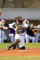 Davidson Wildcats catcher Chris Dyer (19) throws the ball back to his pitcher during the game against the Western Carolina Catamounts at Wilson Field on March 10, 2013 in Davidson, North Carolina.  The Catamounts defeated the Wildcats 5-2.  (Brian Westerholt/Four Seam Images)