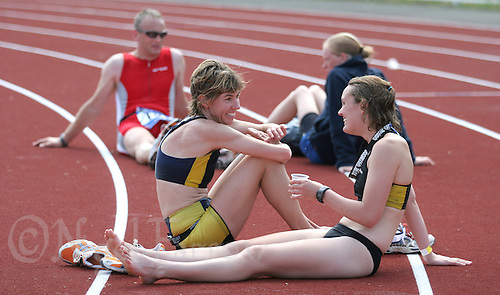 17 JUL 2005 - ASHFORD, UK - Donna James (left) recovers after finishing at the British Triathlon Age Group Championships. (PHOTO (C) NIGEL FARROW)