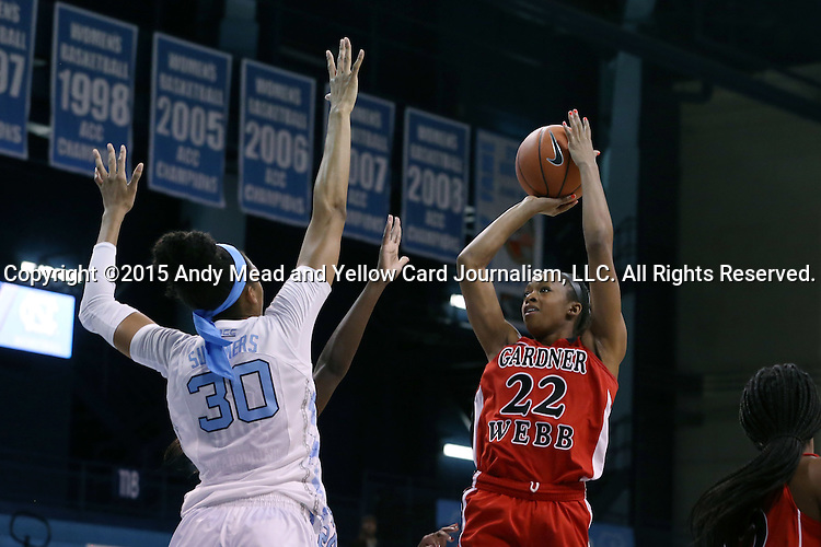 13 November 2015: Gardner-Webb's Candace Brown (22) shoots over North Carolina's Hillary Summers (30). The University of North Carolina Tar Heels hosted the Gardner-Webb University Runnin' Bulldogs at Carmichael Arena in Chapel Hill, North Carolina in a 2015-16 NCAA Division I Women's Basketball game. Gardner-Webb won the game 66-65.
