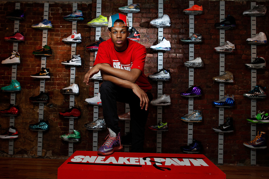 "Chase ""Sneakers"" Reed, 16, in his sneaker pawn shop, Harlem, NY."