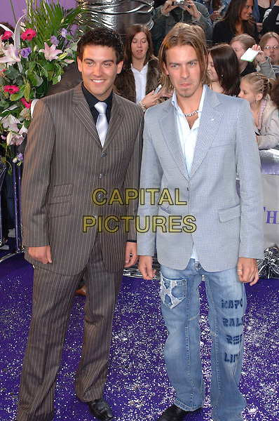 KEVIN SACRE & ASHLEY TAYLOR DAWSON.Arrivals at The British Soap Awards, .BBC Television Centre, Wood Lane, .London, England, May 20th 2006..full length jeans writing blue jacket hollyoaks taylor-dawson funny tongue.Ref: FIN.www.capitalpictures.com.sales@capitalpictures.com.©Steve Finn/Capital Pictures.