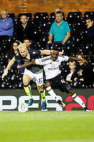Bristol Rovers' Ryan Broom and Fulham's Steven Sessegnon battle for the ball during the Carabao Cup match between Fulham and Bristol Rovers at Craven Cottage, London, England on 22 August 2017. Photo by Carlton Myrie.