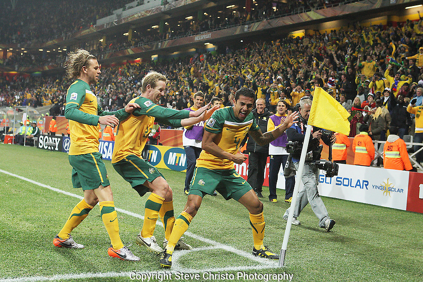 Australia's Tim Cahill celebrates with teammates  Brett Holman (L) and 	David Carney (C) after scoring the first goal against Serbia during the match at Mbombela Stadium, Nelspruit, South Africa. Wednesday 23rd June 2010. (Photo: Steve Christo)