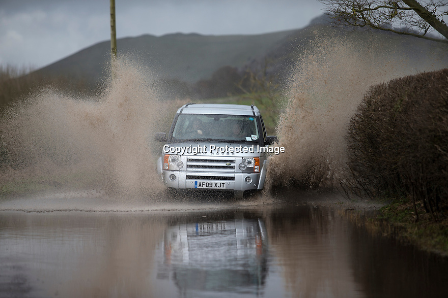 31/03/15<br /> <br /> A car splashes through flood water near Thorpe, in the Derbyshire Peak District.<br /> <br /> All Rights Reserved: F Stop Press Ltd. +44(0)1335 418629   www.fstoppress.com.