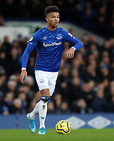 11th January 2020; Goodison Park, Liverpool, Merseyside, England; English Premier League Football, Everton versus Brighton and Hove Albion; Mason Holgate of Everton looks up before passing the ball - Strictly Editorial Use Only. No use with unauthorized audio, video, data, fixture lists, club/league logos or 'live' services. Online in-match use limited to 120 images, no video emulation. No use in betting, games or single club/league/player publications