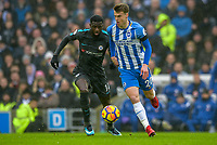 Solly March of Brighton & Hove Albion (20)  and Tiemoue Bakayoko of Chelsea (14)  during the Premier League match between Brighton and Hove Albion and Chelsea at the American Express Community Stadium, Brighton and Hove, England on 20 January 2018. Photo by Edward Thomas / PRiME Media Images.