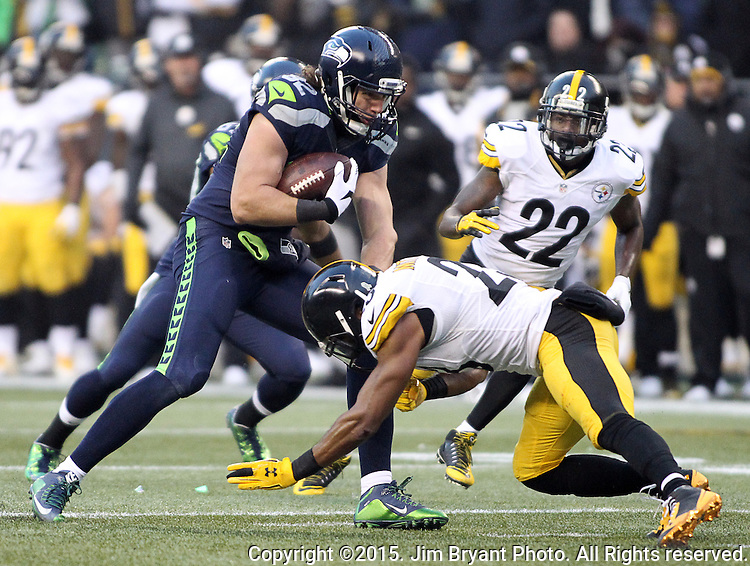 Seattle Seahawks tight end Luke Willson (82) catches a pass before being tackled by Pittsburgh Steelers safety Mike Mitchell (23) at CenturyLink Field in Seattle, Washington on November 29, 2015.  The Seahawks beat the Steelers 39-30.      ©2015. Jim Bryant Photo. All Rights Reserved.